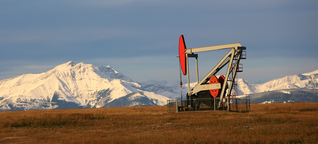 Pumpjack Panorama with Canadian Rockies in Distance