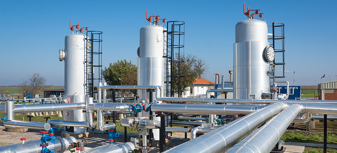 Oil industry equipment installation, metal pipes and constructions.